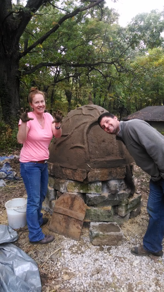 Maria and Chauncey Snodgress at the end of forming the oven.